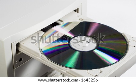 CD/DVD being being inserted into a computer.