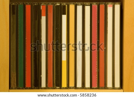 CD in shelf without titles. - stock photo