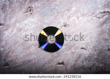 cd on a concrete background - stock photo