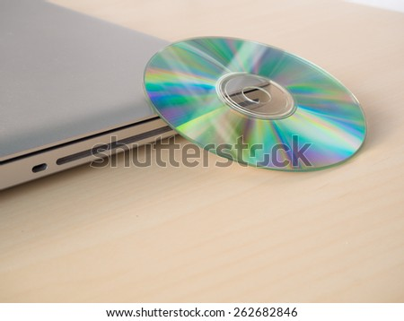 cd or dvd and laptop - stock photo