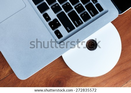 cd-rom or dvd-rom and disc on wooden table. Background for use anything. - stock photo
