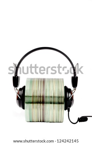 cd with headphones clamped isolated on white background