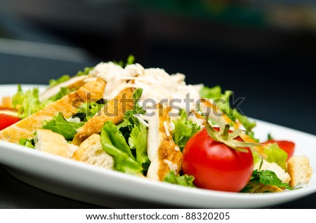 Ceasar salad served in restaurant - stock photo