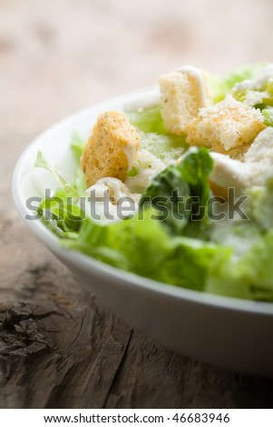 Ceasar salad with lots of dressing and parmesan - stock photo
