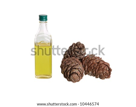Cedar oil in a bottle and cones.  isolated on white - stock photo