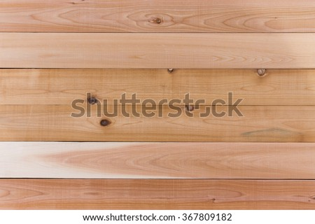 Cedar Wood Wall Background with Copy Space, Emphasizing Horizontal Orientation. - stock photo