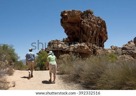 CEDERBERG IN THE NORTHERN REGION OF THE WESTERN CAPE SOUTH AFRICA - CIRCA 1014 - Tourists explore on foot the rugged Cederberg region Western Cape South Africa