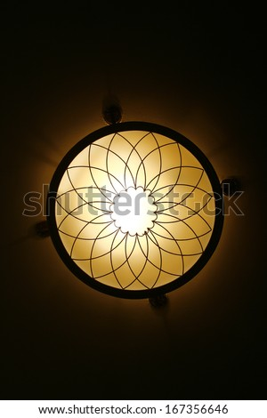 ceiling a chandelier in yellow - stock photo