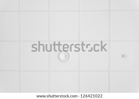 Ceiling detail with a air conditioning hole, standard in every office - stock photo
