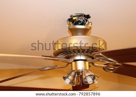Ceiling fan installation stock images royalty free images ceiling fan installation with exposed wires aloadofball Choice Image