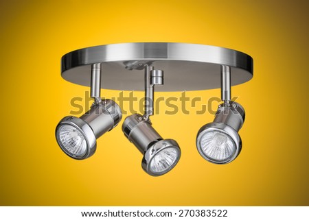 Ceiling light fixture isolated on yellow background - stock photo