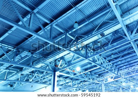 Ceiling of storehouse toned in the blue color - stock photo