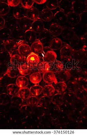 Ceiling with red glowing bottles in pub
