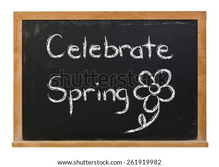 Celebrate Spring written in white chalk on a black chalkboard isolated on white - stock photo