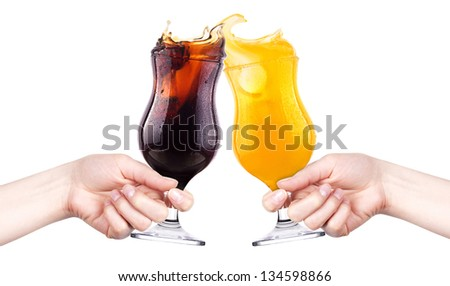 celebrate the holiday background - hands with cola and orange juice making toast - stock photo
