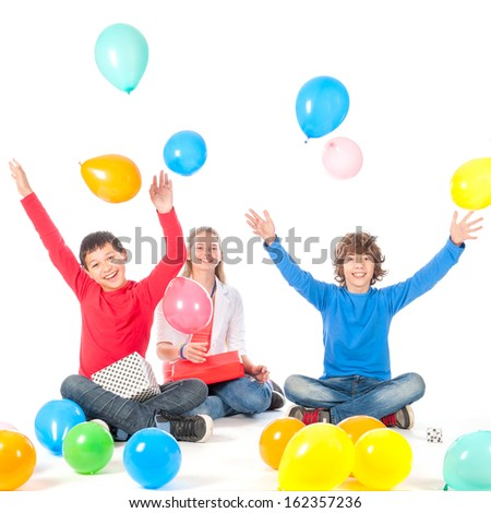 Celebrating a birthday with presents and balloons on a white background