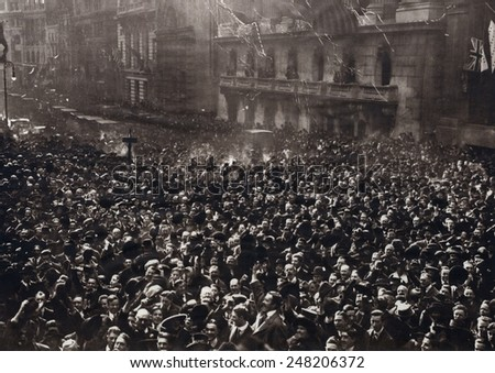 Celebrating American crowd on Peace Monday, Nov. 11, 1918. New Yorkers gathered at Broad and Wall Streets in the Financial District.