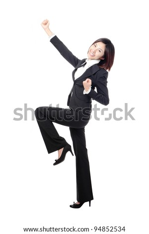 Celebrating cheering businesswoman in full length isolated on white background. model is a asian beauty - stock photo