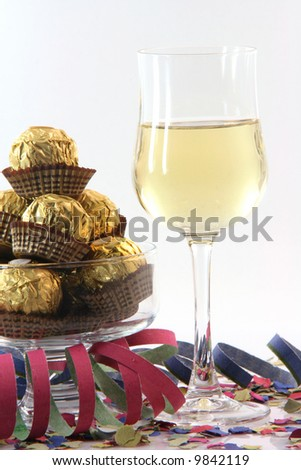 celebration and party time paper confetti streamers wine glass and snacks isolated on white background - stock photo