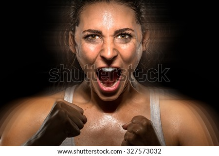 Celebration athlete powerful shouting screaming successful winner champion fighter conceptual roar - stock photo