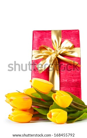 Celebration concept - gift box and tulip flowers