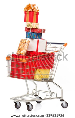 Celebration concept. Many New Year and Christmas presents or gifts represented in shopping cart isolated on white background. - stock photo