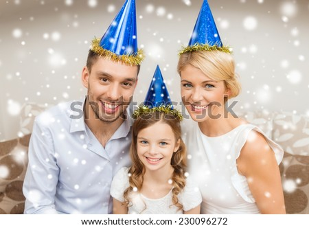 celebration, family, holidays and birthday concept - happy family wearing blue party hats at home - stock photo
