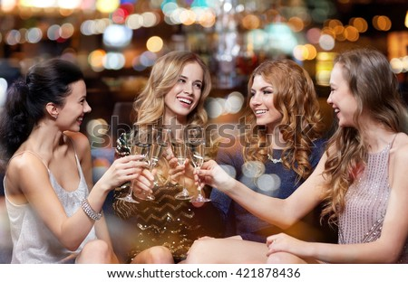 celebration, friends, bachelorette party and holidays concept - happy women with champagne glasses at night club
