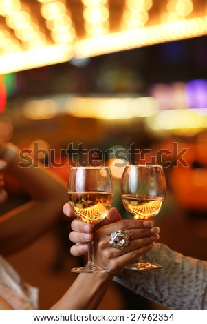 Celebration. Hands holding the glasses of champagne making a toast. Shallow DOF. - stock photo