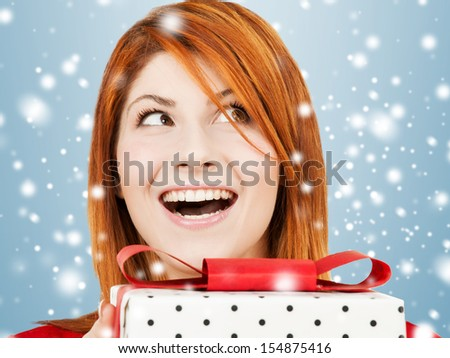 celebration, holidays, xmas concept - happy woman with gift box