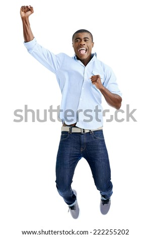 celebration jump of african man with arms out shouting - stock photo