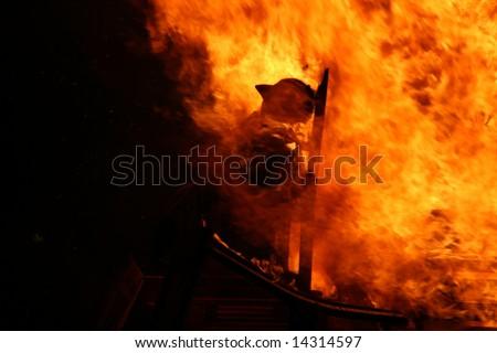 celebration of st joan, a burning man on flames - stock photo