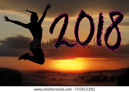 celebration of the New Year 2018 silhouette of young woman jumping on the beach