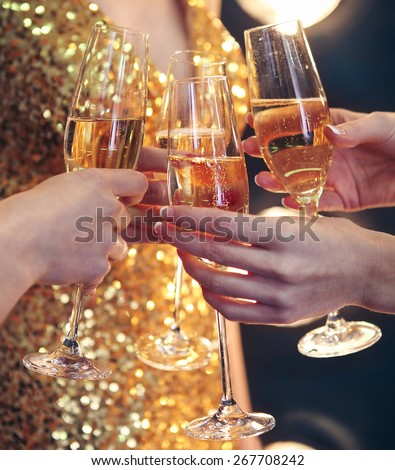 Celebration. People holding glasses of champagne making a toast. DOF. Natural light. Photo in motion. Toned image - stock photo