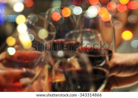 Celebration. People holding wineglasses. Blurry background - stock photo