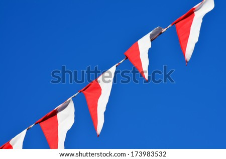 Celebration picture of bunting against a blue sky - stock photo