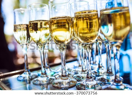 Celebration. Pyramid of champagne glasses. - stock photo