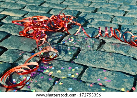 Celebration streamer on the ground - symbol for celebration and party - stock photo
