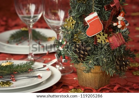 Celebration table with christmas decoration in red tone - stock photo