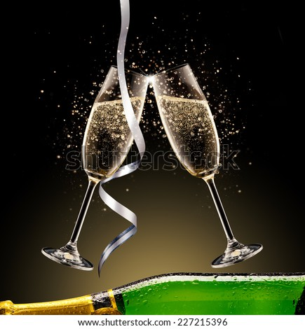 Celebration theme. Glasses and bottle of champagne with bubbles, isolated on black background - stock photo
