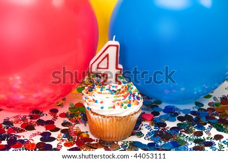Celebration with balloons, confetti, cupcake, and number 4 candle.