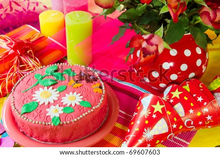 celebration with birthday cake hats and presents - stock photo
