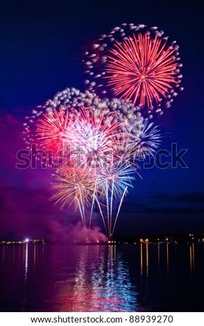 Celebratory bright firework in a night sky - stock photo
