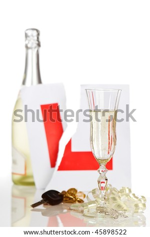 Celebratory champagne for passing driving test - stock photo