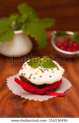 Celebratory chocolate cake with mint on a wooden background