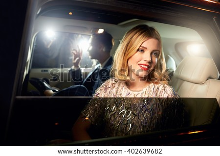 Celebrity couple in back of a car, photographed by paparazzi - stock photo