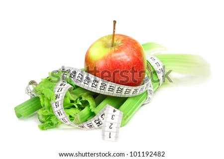 Celery apple and measure tape diet concept isolated on white - stock photo