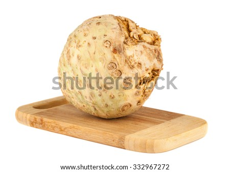 Celery root on chopping board over white background - stock photo