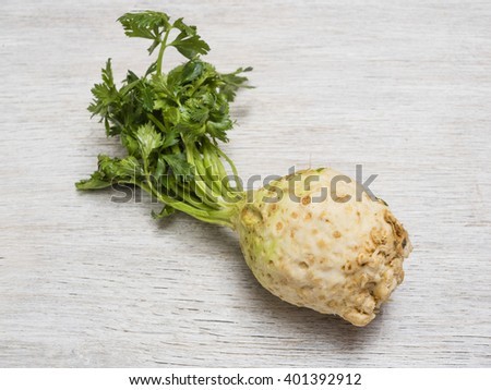 Celery root on wooden background - stock photo