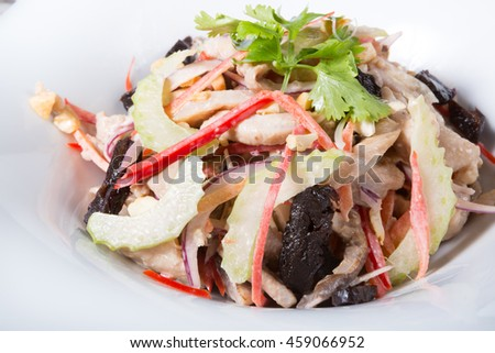 Celery salad with nuts, fruits and mixed vegetables